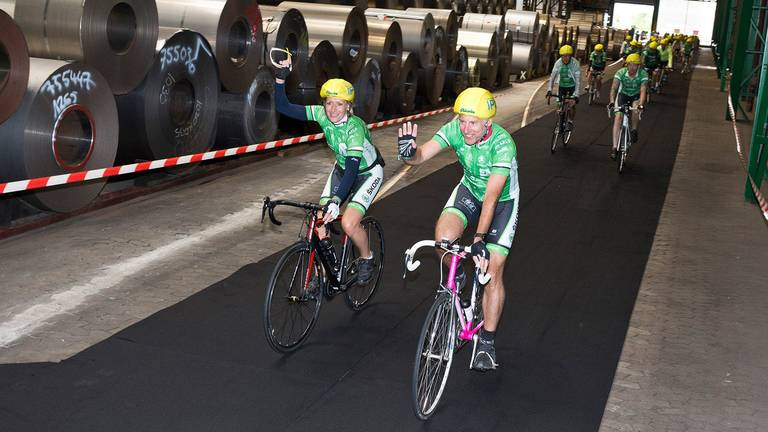 Cyclists ride through the Waelzholz plant in Hagen as part of the Tour of Hope charity event.